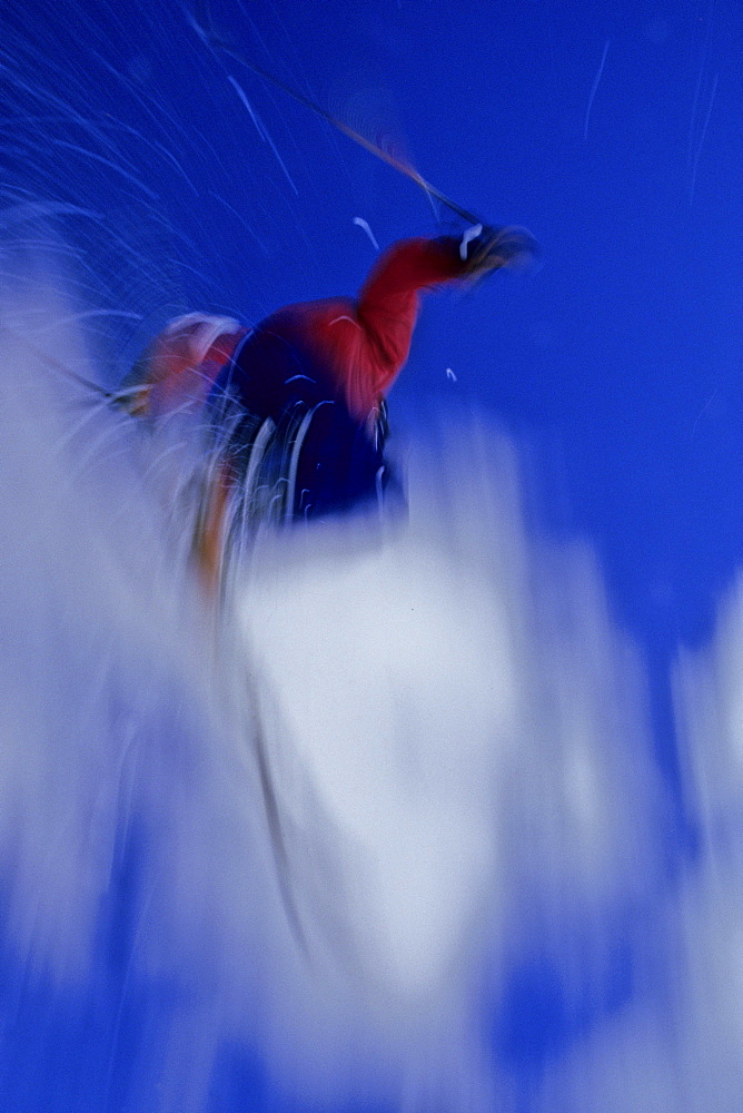 Telemark skier Jeremy Haas catches some big air off the cliffs at the top of Highlands Bowl, Highlands Ski Area, Aspen, CO. (motion blur)