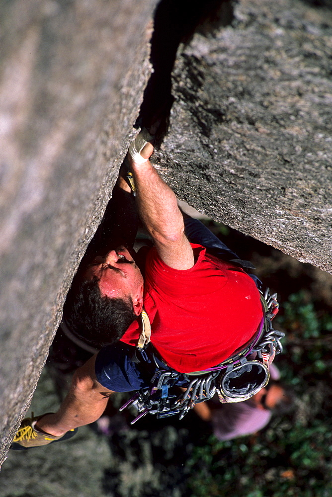"""Bill Saul jams the strenuous crack called """"Oh My God Corner"""" (5.10+) at the God Crags on Old Rag Mountain in the Shenandoah National Park, VA"""