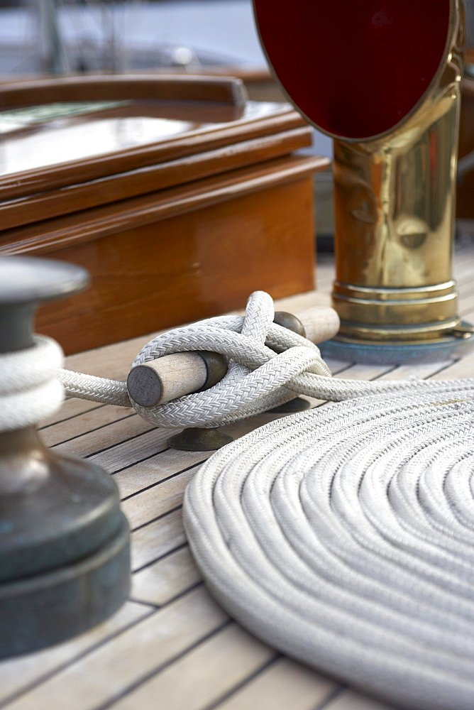 "WInch, cleat and coil on deck of sailing yacht ""Sincerity."""