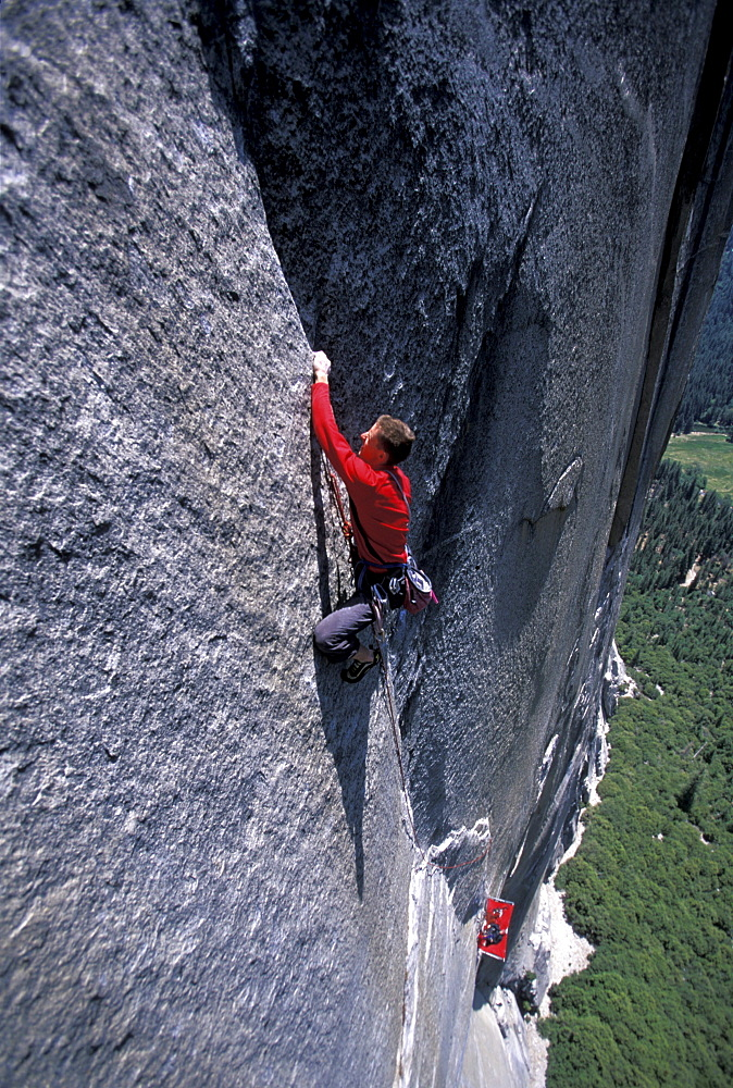 Big wall climber Tommy Caldwell rock climbing Dihedral wall, a multi pitch route on El Capitan in Yosemite National Park, California.