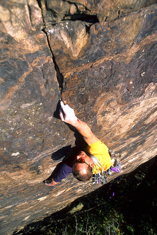 Male rock climber at the New River Gorge, West Virginia.