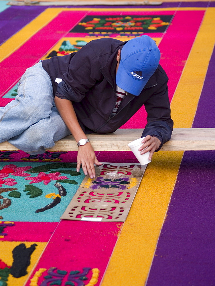 As part of the observance of Lent in Guatemala, a person prepares an aromatic carpet for a procession in Antigua, Guatemala.