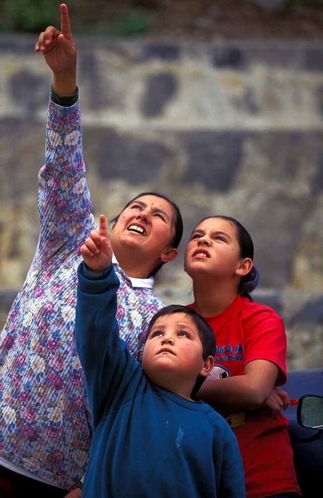 Local villagers look up and point as they watch climbers at El Potrero Chico, Mexico.