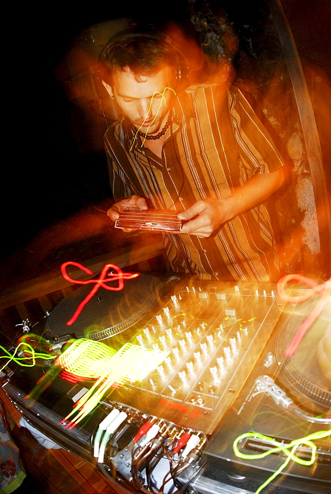 DJ works a record. Squamish, British Columbia, Canada