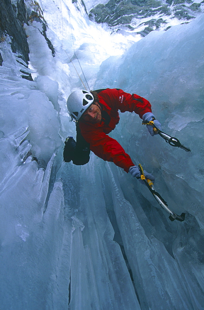 Philippe Magnin, ice climbs a frozen waterfall
