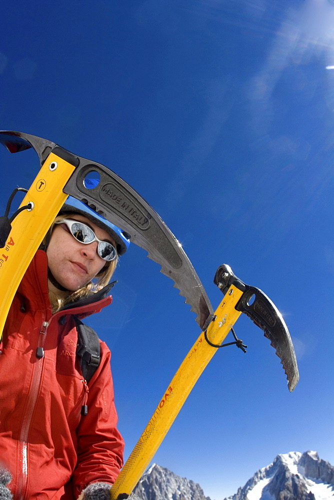 A climber with two ice axes
