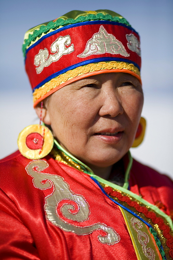 A local Buryat woman involved in a traditional wedding ceremony on Olkhon Island, Siberia, Russia.