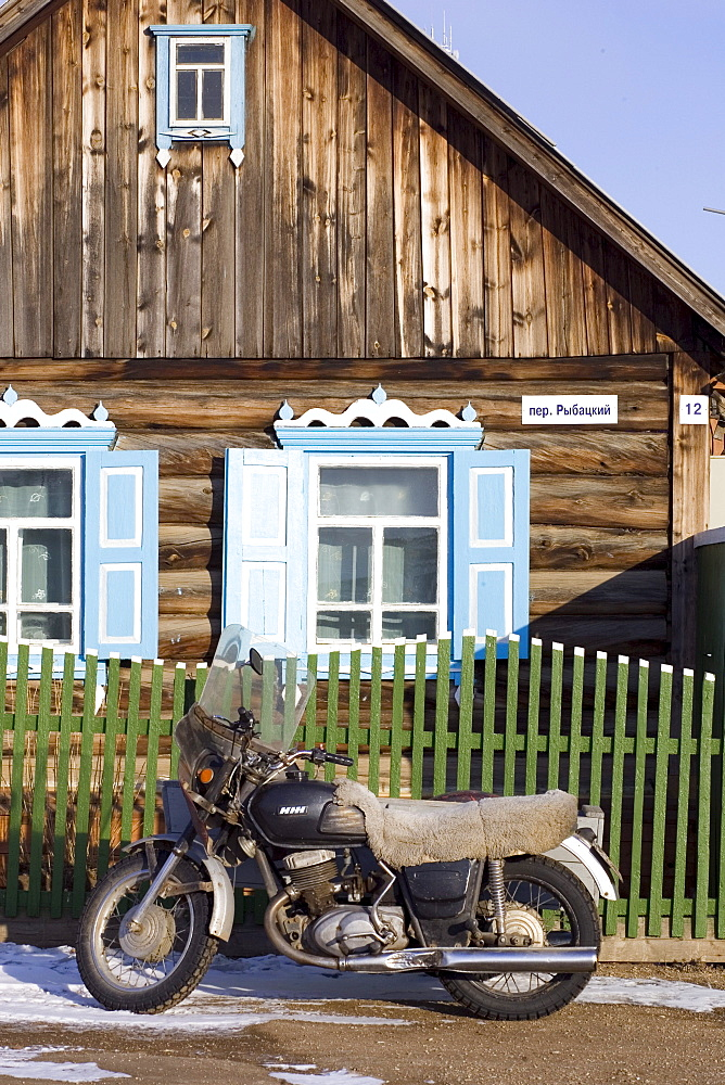 A motorbike parked outside of a home in a local village on Olkhon Island, Siberia, Russia.