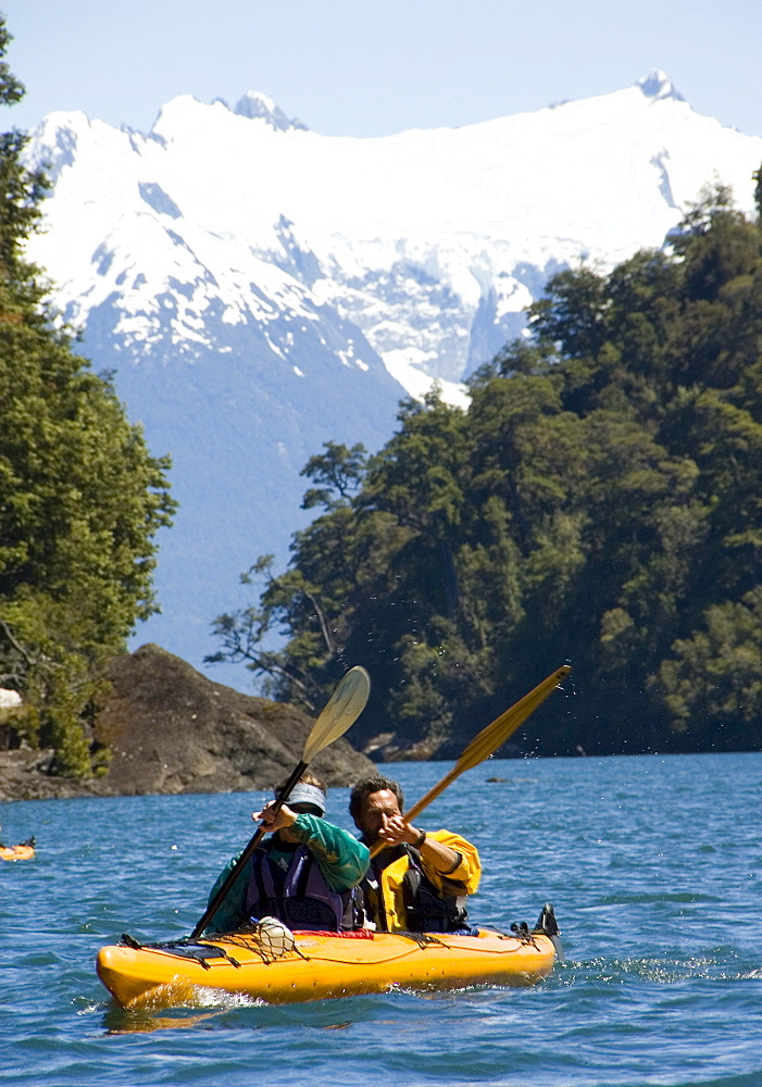 Two people kayak in Lago Yelcho, Chile.