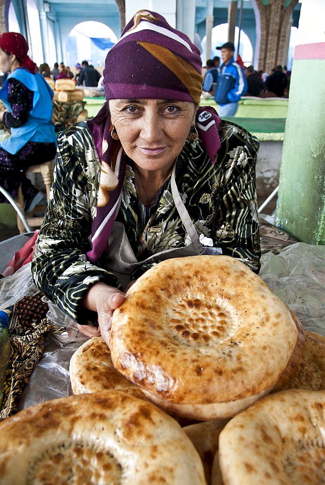 Traditional bread vendor in a market of  Samarkand, Uzbekistan