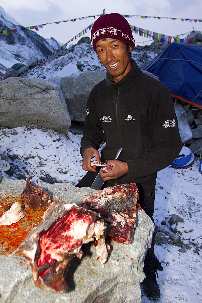 The cook for Jagged Globe Everest Expedition prepares Yak meat at Everest Base Camp