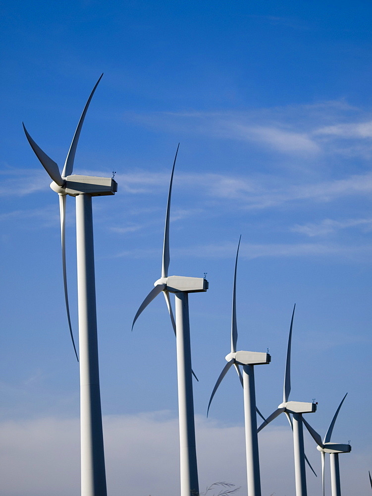 Windmills for electric power at work.