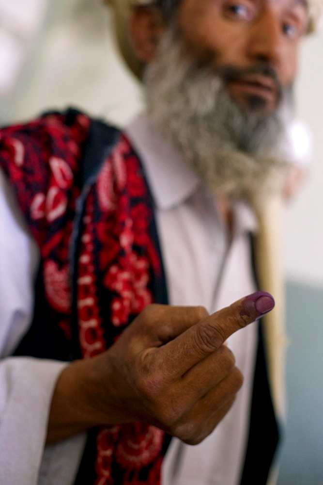 Afghan men vote on the day of presidential and provincial elections in Mazar-i Sharif, Afghanistan, August 20 2009