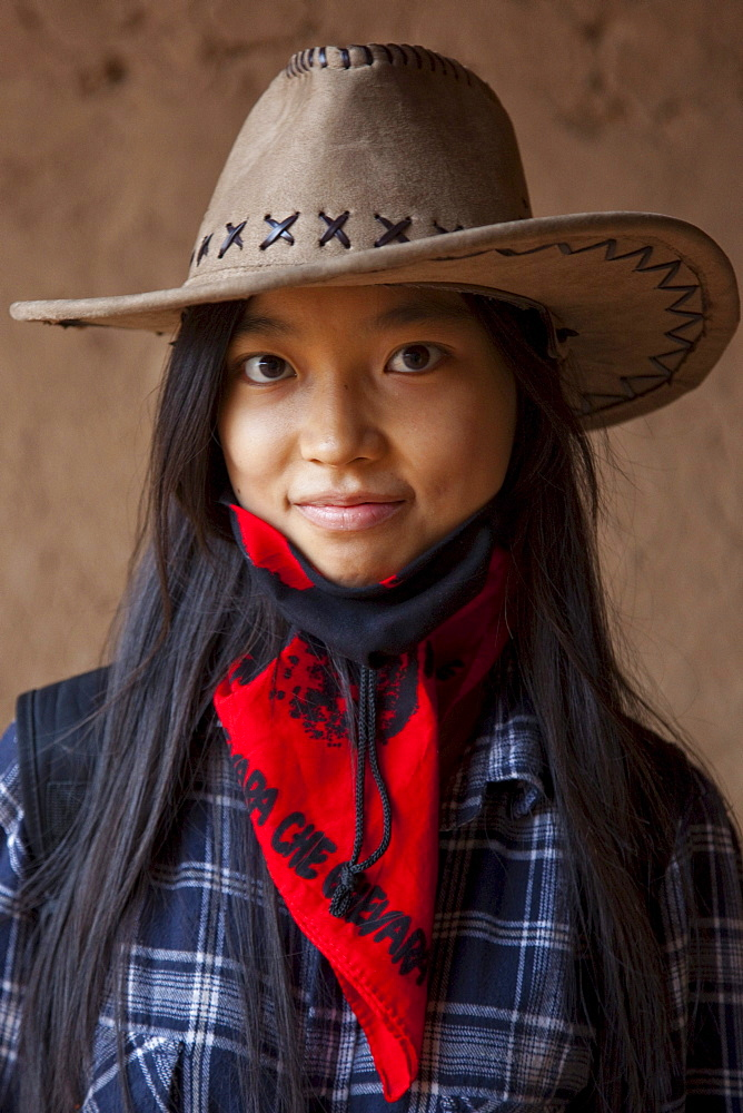 Portrait of a teenage girl in Toyuq, Xinjiang, China.