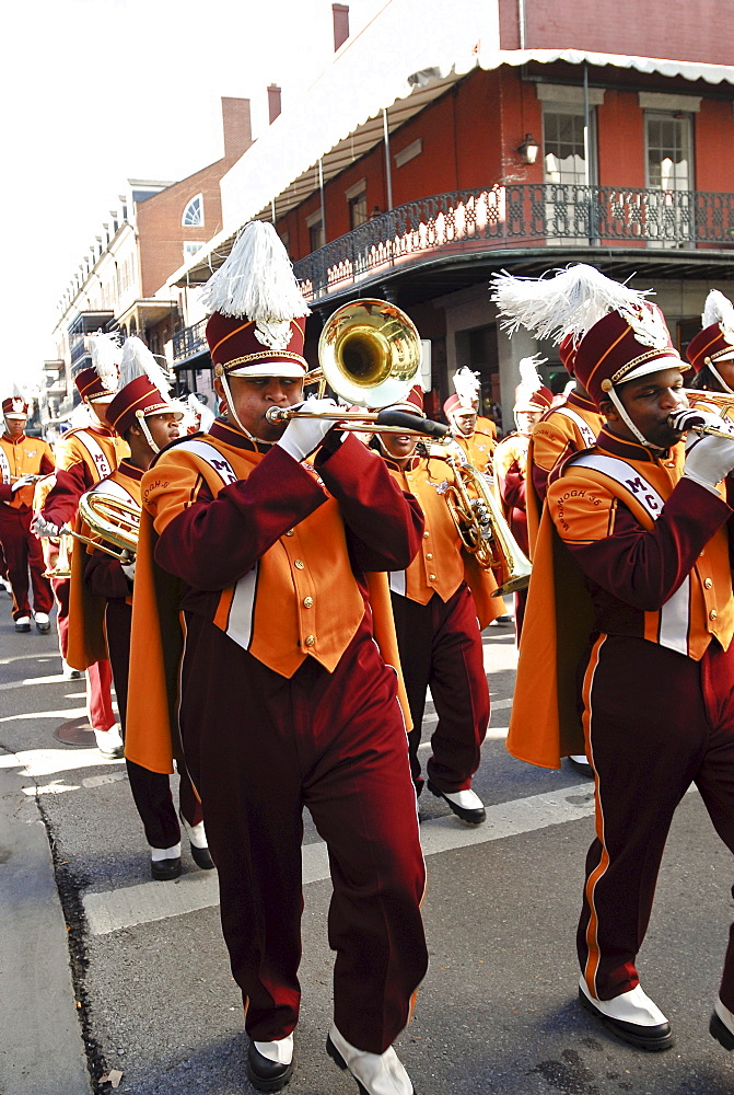 High school marching band at a Mardi Gras Parade in the French Quarter.