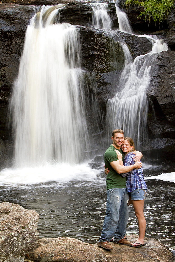 A couple at a waterfall.