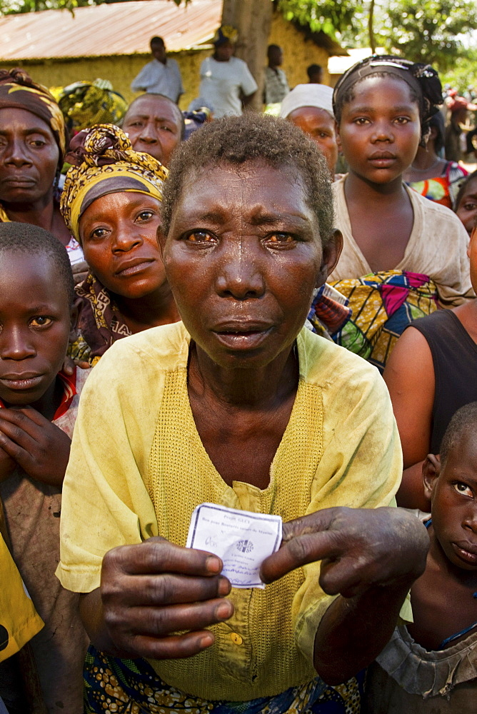 Congolese Villagers wait for food aid