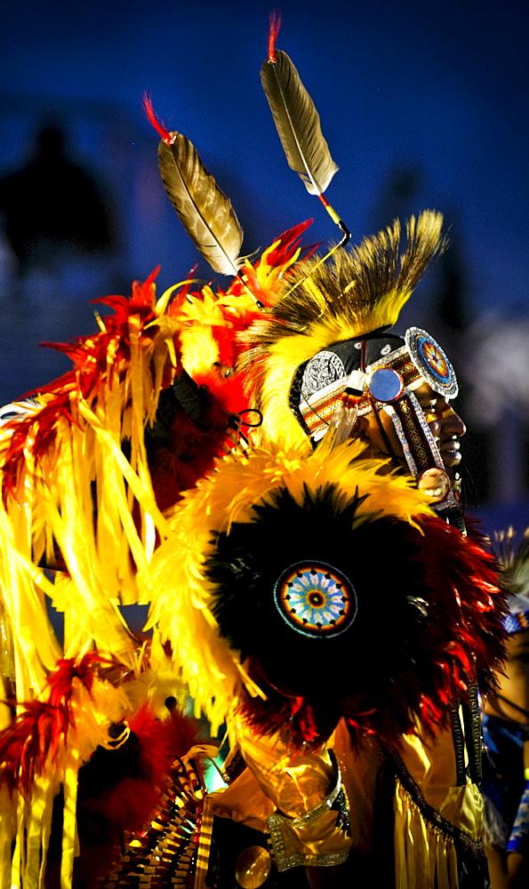 A Native American man participates in a dance at a powwow in Mesa Verde, Colorado.