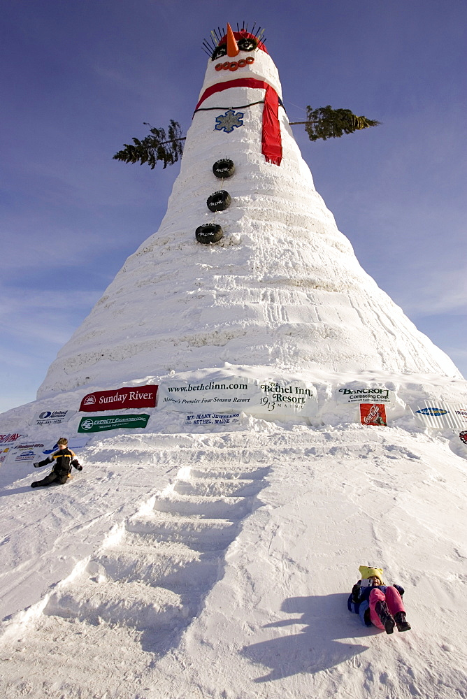 People view the world's tallest snowman, actually a snow woman named after US Senator Olympia Snowe. The Guinness Book of World Record snowman, built the winter of 2007-08, in Bethel Maine, measured 122 feet tall, and used an estimated 13 million pounds of snow.
