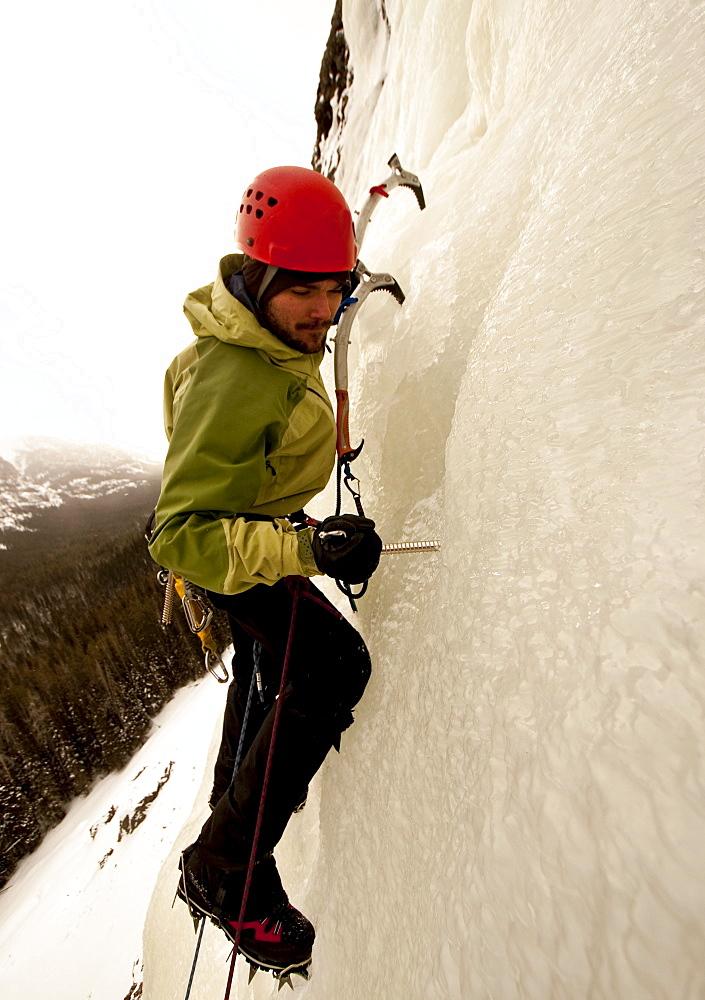 A man ice climbing.