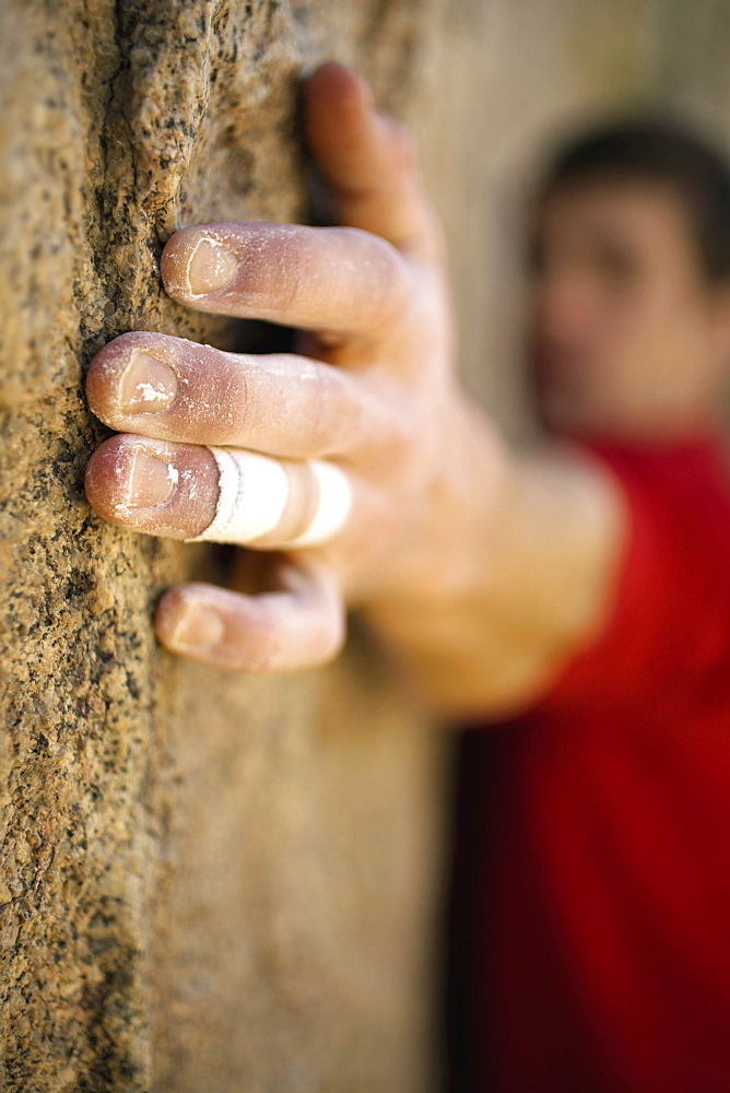 Male climber's hand on rock.