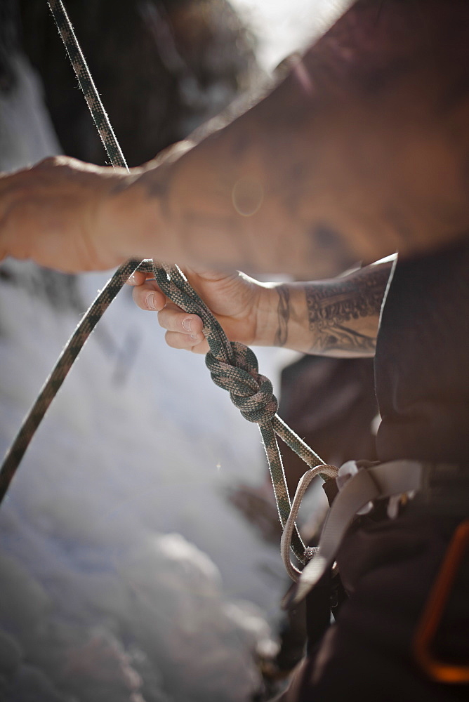 A climber ties a knot in Whistler, British Columbia, Canada, Whistler, British Columbia, Canada