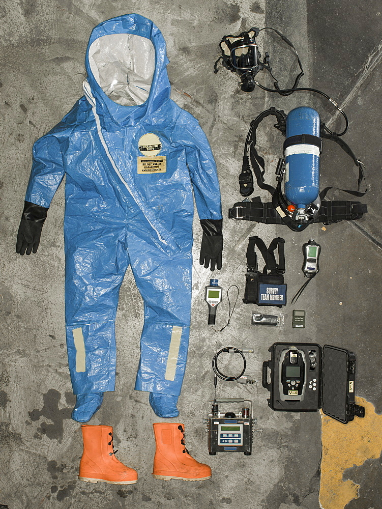 Nuclear radiation suit and accessories hangs on the wall.