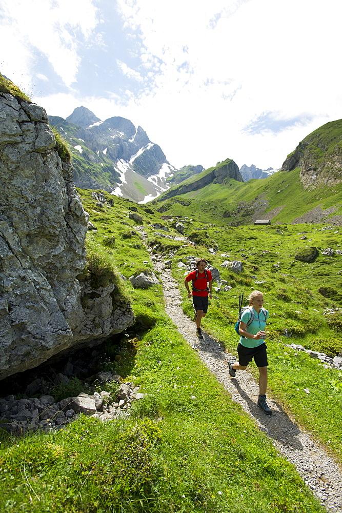 Regina Kinzner and Jochen Reiser hiking in the mountains of Appenzellerland, Switzerland.