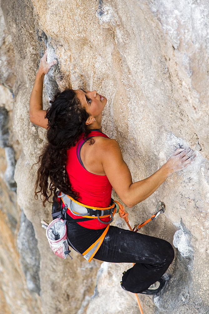 Spanish climber Daryah concentrates on her next move while she is climbing at the Jurassic Park sector in Kalymnos, Greece.