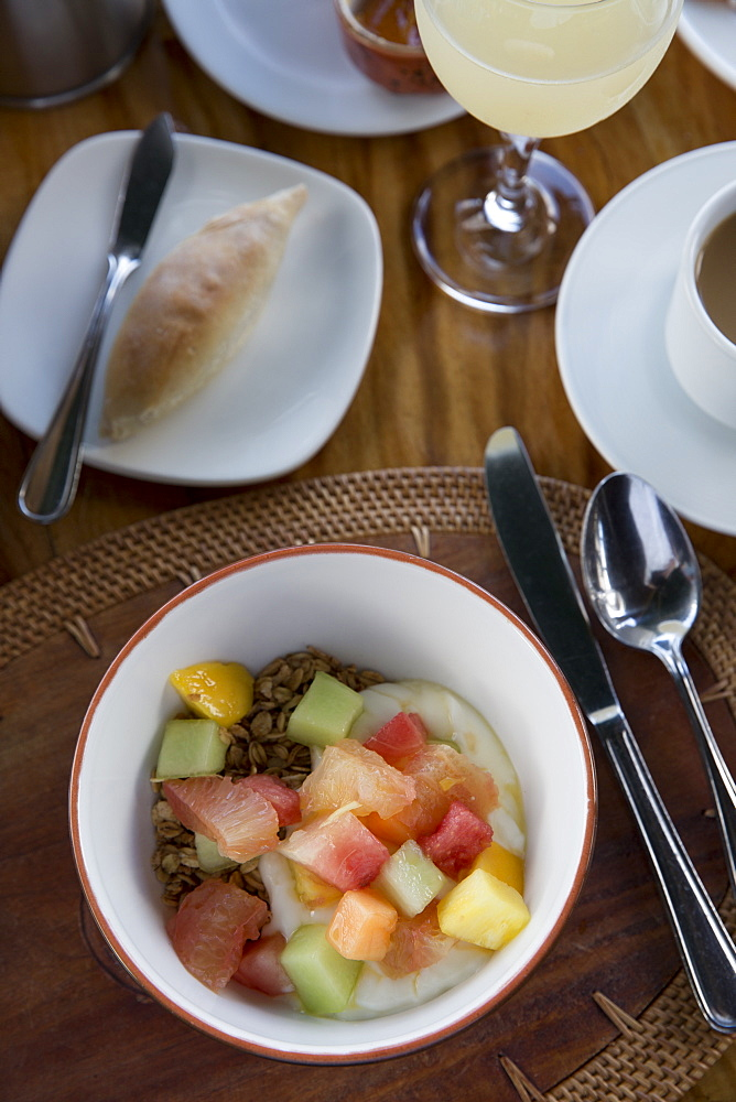 A breakfast spread of fruit and granola