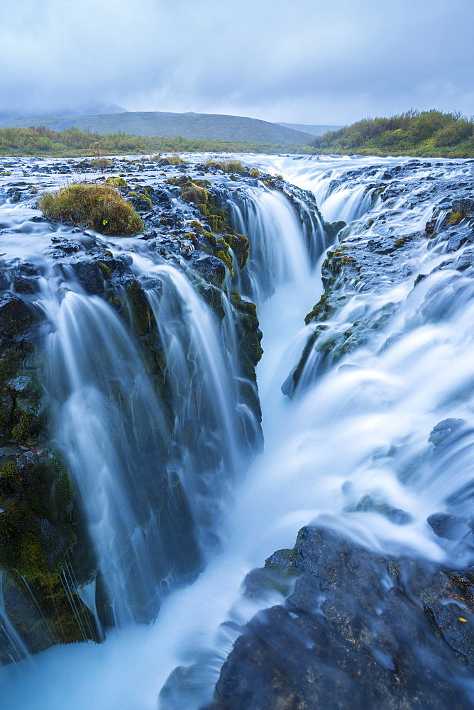 A unique waterfall that falls into an old vocanic fault known as Brúarfoss in Iceland.