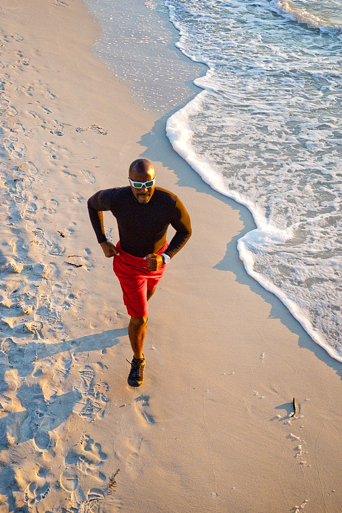 Man running on the beach, from above