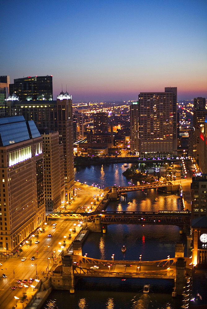 City lights glow at dusk on a clear evening, United States of America