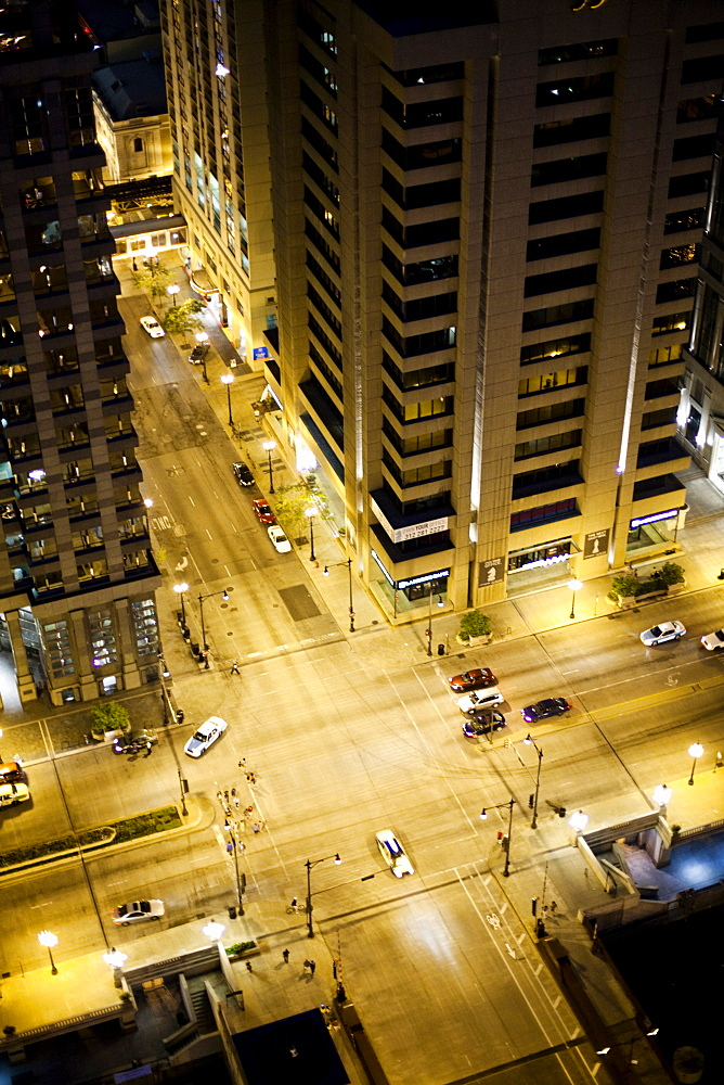 An aerial view of a busy intersection in a large city at dusk, United States of America