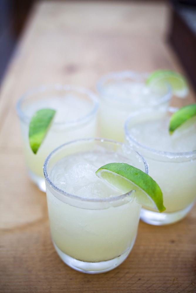 Four delicious looking margaritas with limes in Todos Santos, Baja California Sur, Mexico