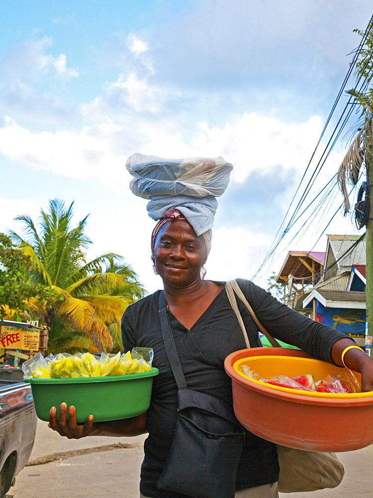 Unidentified food vendor peddles her wares in West End, the largest settlement on Roatan.