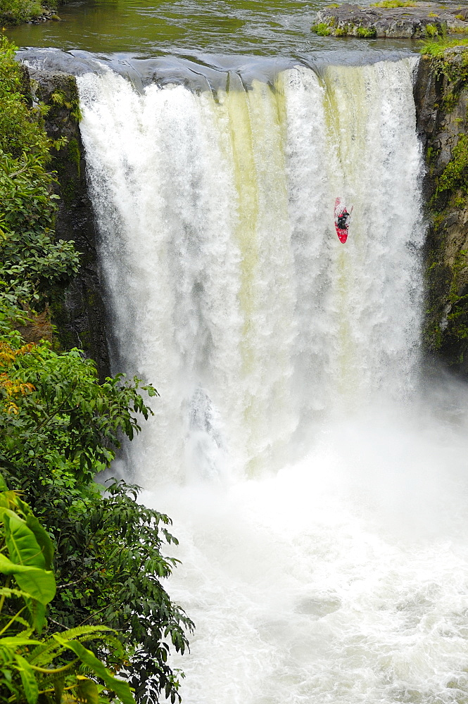 A man kayaks down a waterfall on the Alseseca River in the Veracruz region of Mexico, United States of America