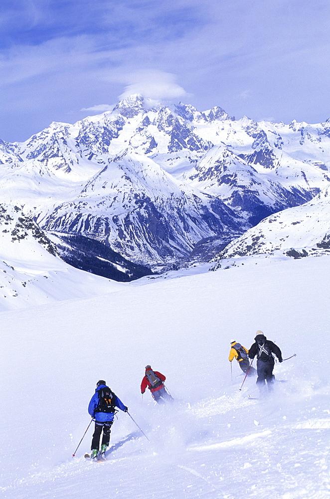 Skiers skiing on Glacier Du Ruitor (Mt Blanc), La Rosiere, France, France