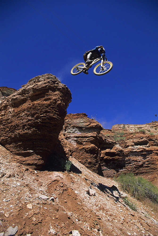 Wade Simmons dropping a cliff in Virgin, Utah, United States of America