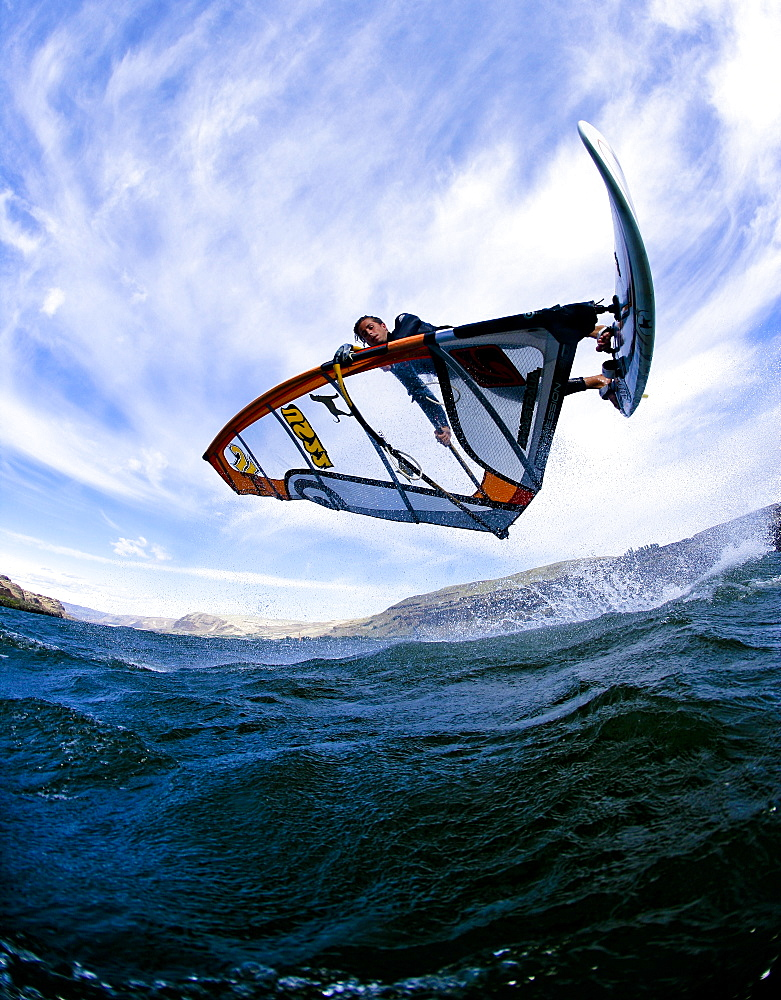 Windsurfer extends a shove it during a summer session at the Wall, United States of America