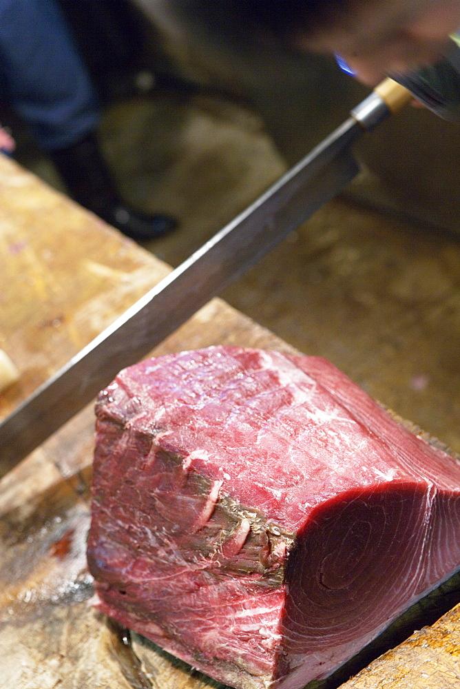 Close-up of fresh tuna being cut at fish market, Tokya, Japan, Japan