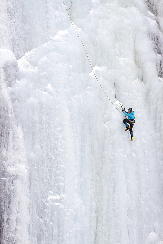 A  woman ice climbs on Blodgett Falls in the Bitterroot Mountains of Montana.