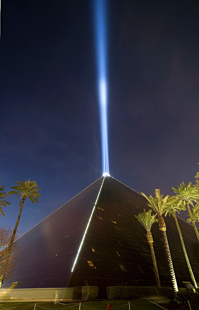 Pyramid with a light beam shooting out of the top.