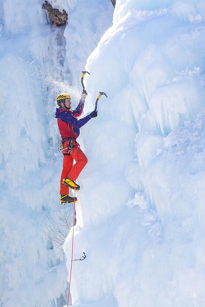 A man ice climbing near Ouray, Colorado.