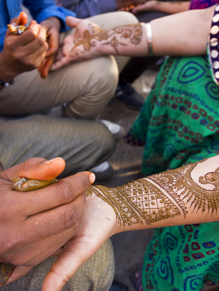 Henna being applied on woman's hand in Jaipur, Rajasthan, India