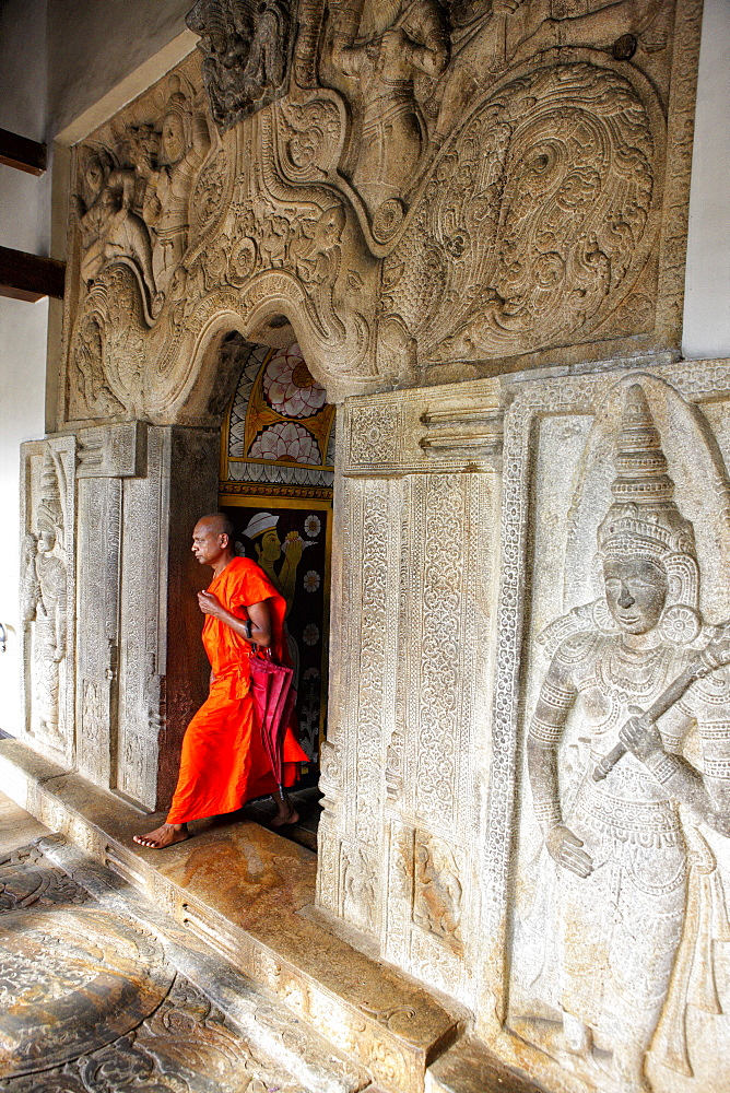 A monk at the temple of the tooth, Kandy, Sri Lanka. (Sri Dalada Maligawa