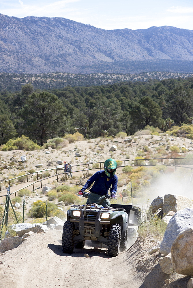 Volunteers take part in a cleanup event hosted by Outdoor Life, Yamaha and the Southern California Mountains Foundation at the Cactus Flat OHV Staging Area in the San Bernardino National Forest on Sat., Sept. 26, 2015.