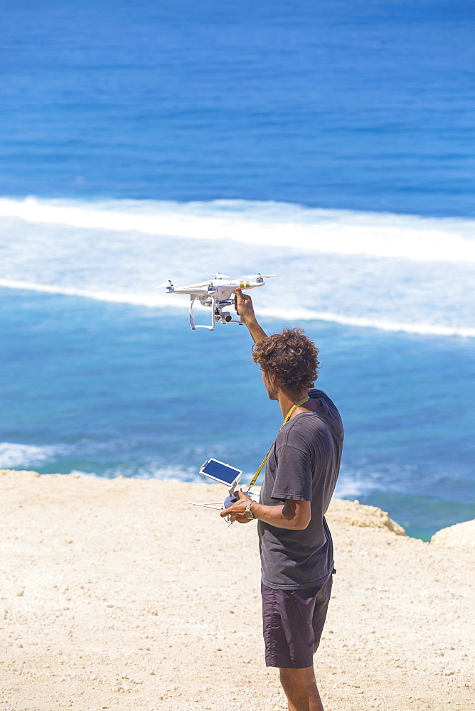Man with controlled drone on the beach - 857-93075
