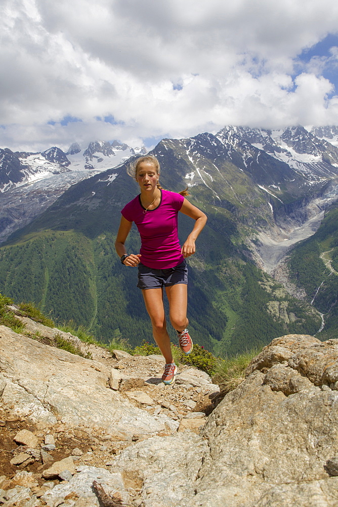 Girl Running Uphill In The Chamonix Valley