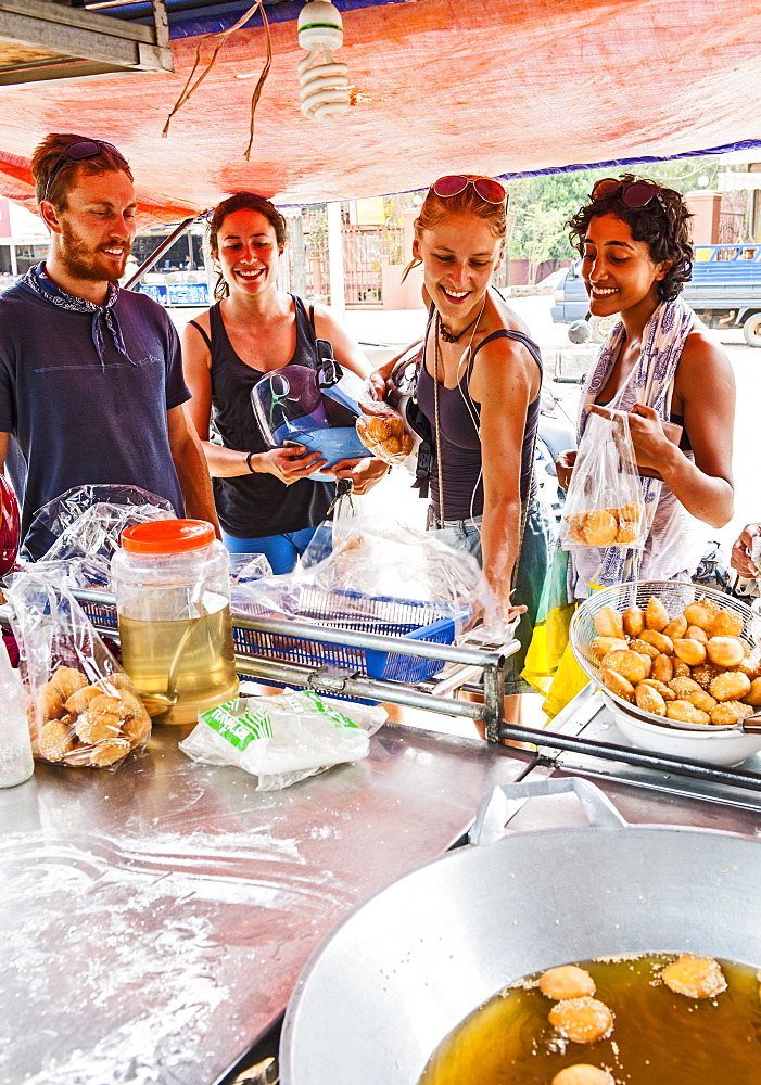 Group Of Happy Friends At Street Food Stall
